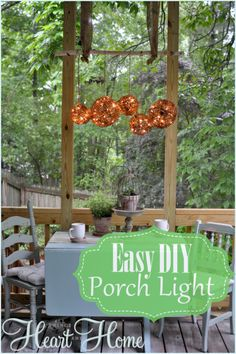 DIY Porch Light.. Need 2 large grapevine balls, 3 medium grapevine balls, 2 sets of 50 count white lights with brown wires, Garden twine, Birch branch,  and Burlap ribbon. Click photo for directions on how to make your own.