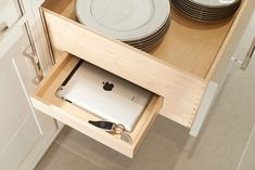 A secret drawer in a bespoke kitchen hides an iPad and car keys
