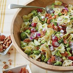 Broccoli, Grape and Pasta Salad  1 cup chopped pecans   1/2 (16-oz.) package (bow-tie) pasta   1 pound fresh broccoli  1 cup mayonnaise   1/3 cup sugar  1/3 cup diced red onion   1/3 cup red wine vinegar   1 teaspoon salt   2 cups seedless red grapes, halved   8 cooked bacon slices, crumbled http://media-cache7.pinterest.com/upload/135600638750465899_Xh473kjt_f.jpg libraryria recipes