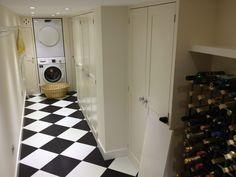 Finished narrow basement utility / laundry / storage room