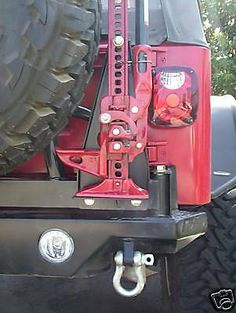 Easy to install Hi Lift Jack Mount for the Jeep Wrangler is constructed of heavy duty steel. Hi-Lift Jack Mount for Jeep Wrangler. The Jack Mount installs with Grade 5 bolts on to your tire carrier. 2006 Jeep Wrangler, Jeep Tj, Jeep Wrangler Accessories, Jeep Accessories, Jeep Tire Carrier, Hi Lift Jack Mount, Toyota Runner, Tactical Truck, Overland Gear