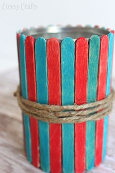 Popsicle Stick Vases - Fun 4th of July craft for the kids!  Use them to hold cut flowers or as utencil holders at your 4th of July party.