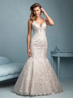 Allure Bridals 9203   Pearlescent rose gold embroidery is the highlight of this striking gown.