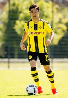 Dortmund's Shinji Kagawa poses during the team presentation of Borussia Dortmund on August 17 2016 in Dortmund Germany