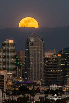 Huge Full Moon over Downtown by Evgeny Yorobe