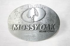 Mossy Oak Logo metal belt buckle. ohh very much need this one!!!
