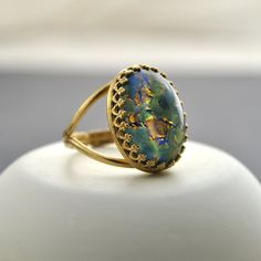 This green and blue glass fire opal cabochon gemstone ring is absolutely stunning. Each fire opal stone is completely unique - no two rings will be. Gold Fashion, Fashion Rings, Fashion Jewelry, Gold Jewelry, Women Jewelry, Jewellery, Pendant Jewelry, Jewelry Rings, Lapis Lazuli Jewelry
