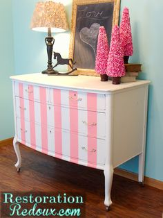 Restored old dresser becomes cute and classy with pink stripes.