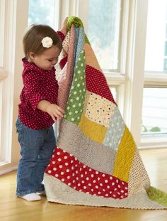 Show off polka dots of all colors and sizes in a super-size Log Cabin block.