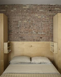 In the master bedroom, the top of the platform bed is hinged on one side and lifts like the cover of a book. New York, New York Dwell Magazine : November / December 2017