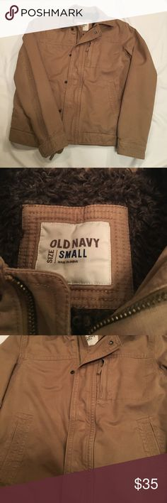 {Old Navy} men's jacket Khaki, soft, light weight denim jacket lined with a dark brown faux shearling type lining. Warm & cozy, great condition  {Old Navy} jacket. Faux shearling lining covers body of jacket, and sleeves are lined with khaki colored satin. Zipper & snap closure with snap closure at wrists. Three outside pockets, breast pocket is zippered closure. One inside breast pocket. Old Navy Jackets & Coats