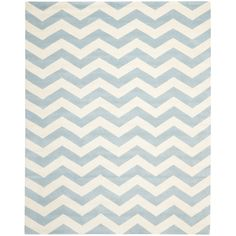 This handmade chevron rug features an attention-grabbing geometric pattern that gives your contemporary design a bit of a kick. Its light blue coloring is relaxing, and the handmade construction ensures that no two rugs are exactly alike