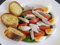 Mackerel Salad with Bruschetta - Simply poached mackerel is cooled before being served on a tasty salad bed with hard boiled egg and bruschetta