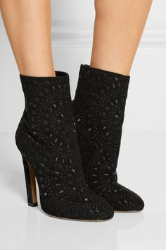 Alaïa's black suede boots have a cool, embroidered floral medallion motif. Cut to hit at a flattering point above your ankle, they have a full leather lining that ensures a comfortable fit. Wear this versatile pair with everything from mini dresses to tailored pants.