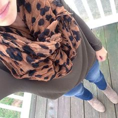 Olive top, leopard scarf.