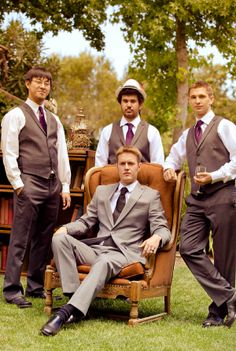 Groom in chair with groomsman