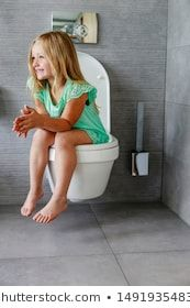 Smiling Little Girl Using Toilet At Home Stock Photo 5 10 Years