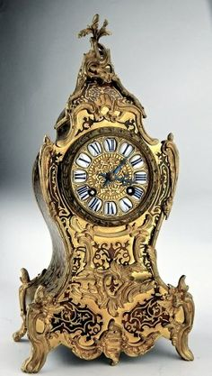 """19th Century French Boulle Clock, Gilt bronze mounted , porcelain cabochon roman numerals, movement has foundry mark """"Medaille Larceny Vincenti & Cie 1855"""" numbered 224 55"""