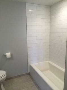 White Subway Tile With Delorean Gray Grout Also Exposed