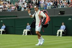 Roger Federer greets fans before his opening round match. - Neil Tingle/AELTC