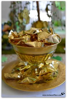 Decorating the Table for a St. Patrick's Day Celebration - pot o' gold: gold-wrapped butter mints in a antique gold dessert set