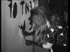 "Cutting('67-'68)- cinematic technique of ""cutting,"" or editing, and its importance in the construction of filmic reality. A house is projected onto a paper screen and the window is cut with scissors. Next, Marshall McLuhan's sentence: ""The content of the writing is the speech"" is cut out of the screen. Then, the naked body, serves as a living screen, the sign of which is shaved by the artist. The fellatio at the end shows the most direct form of communication which eschews words and images."
