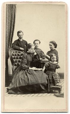 https://flic.kr/p/RKXcTV | Five Sibs | Carte de visite by an anonymous photographer. Five children ranging in age from a youngster of about three to teenagers poses for a portrait. The child in the center places her hands over a tray of marbles, and one of the teenaged girls points her index finger at a passage in a book. It is likely that they are siblings.  I encourage you to use this image for educational purposes only. However, please ask for permission.