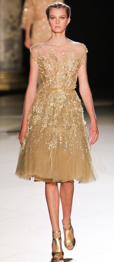 Elie Saab Fall 2012 Couture,Sigrid Agren. (Gold knee length embroided dress, 50's style A-line flare)