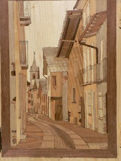 Novalesa Via Maestra . Intarsio in legno di colori naturali. Spessore tarsie 5 mm.