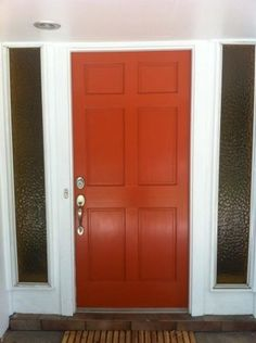 Try A Bright Orange Front Door With Dark Grey Siding To