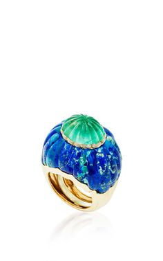 This ring by **David Webb** features a dome shape with a cabochon emerald at the center, fluted azurmalachite detailing, fashioned in 18K yellow gold.