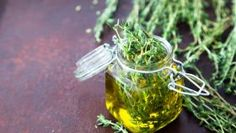Thyme oil. Thyme essential oil jar glass bottle