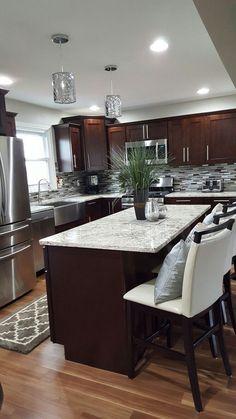 Dark Espresso Cabinets With Sleek Modern Appliances, Contemporary Bar  Stools, Chrome Pendant Lighting. Great Kitchen Remodel Ideas, Wood Flooring  In Tab ...