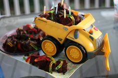 Dirt and Worms Dump Truck Cake. This would be very cute for a little boys Birthday Party!
