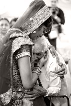 Bride and Grandpa ...saying goodbye to your side (as the bride) as you go to your new home is the most emotional part of an indian wedding. nothing but tears