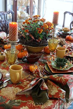 A bit cluttered, but it's still homey and would work for any autumn meal. The mugs are for cider or coffee. :o)