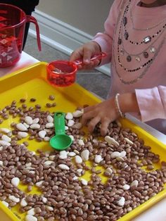 Everyday sensory play for preschool activities. Have different measurement tools and kinds of beans with of different sizes for the students to measure. Dap allowing different options for measuring.
