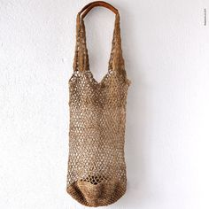a hand crochet Market bag made from #Allo or #theHimalayanNettle, and Organic Vegetable Leather. From #Kolpa