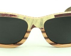 Wooden Sunglasses handmade from upcycled skateboards by Wooden Sunglasses, Wayfarer, Skateboard, Eyewear, Upcycle, Trending Outfits, Unique Jewelry, Handmade, Style