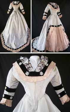 Reception dress, ca. late 1860s. This gown shows both the extended train and narrow hips of the period. Three pieces (removable self-fabric chemisette, bodice, skirt). Gray & gold shot taffeta trimmed with peach taffeta pleats. Yards of black silk velvet ribbon, hand-embroidered in stylized daisy motif, outline pleats & trim bodice. Elaborate pleated trim on bodice. Skirt closes left front with hooks & eyes. Bodice laces up back and chemisette. Antique Frock.com