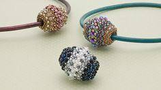 Create a cleverly constructed beaded bead using a wood barrel, seed beads, and fire-polished beads