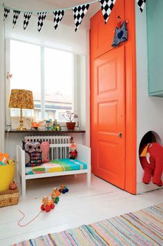 Love this orange door in a colorful Swedish family's home