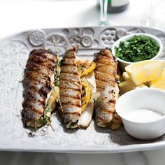 Barbara Lynch stuffs her grilled branzino with lemons and herbs, then grills the European sea bass until the skin is browned and crispy.