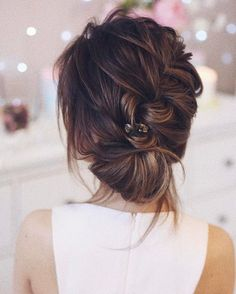 Beautiful braided and twisted updo wedding hairstyle for romantic brides. Get inspired by this braid updo bridal hairstyle,updo messy wedding hairstyles