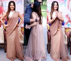 """Bollywood actress Sunny leone in saree at """"kuch kuch locha hai"""" movie promotions. She was beautiful in green transparent saree with silver high neck blouse"""