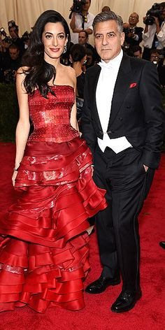 """AMAL AND GEORGE CLOONEY in a bright red custom Maison Margiela """"Artisanal"""" by John Galliano"""