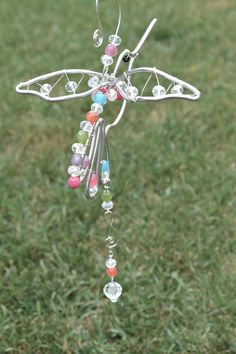 Wired Bird Sun Catchers:  Silver Wire Hummingbird suncatcher beaded with swarovski clear crystal beads and jade dyed multi colour faceted beads with crystal prism. Absolutely beautiful. Our Store: www.coirnini.com -or- www.facebook.com/coirninico