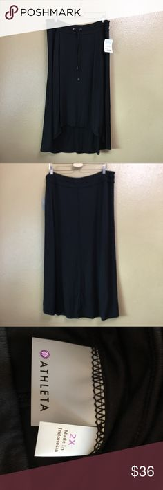 """Athleta BeachComber Pura vida Midi Skirt Size 2X Name Brand: NWT ATHLETA  $54 NEW BLACK BEACHCOMBER PURA VIDA MIDI  SKIRT  PLUS 2X  Condition: NWT  Size: 2X (see measurements)  Color: Black  Style: Skirt  Material: 95% Rayon 5% Spandex Always check the measurements, label sizes are not consistent. Measurements are approximate, and are of item laying flat and unstreched: Waist: 19 """" Length: 35"""" (from waist to hem) Athleta Skirts Midi"""