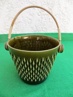 I thought this was a Planter, but have since found out it is an Ice Bucket. Either way it has a beautiful raised lozenge pattern.
