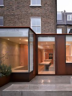 Rusty steel extension to a west London home by McLaren Excell